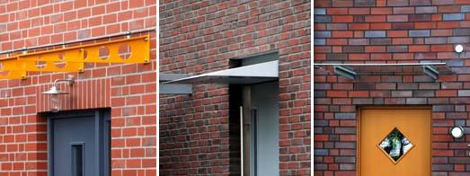 Vordächer an Klinkerbauten, Metall/Glas oberhalb des Sturzes, Metall mit Türelement als Einheit, minimales Metall/Glaselement