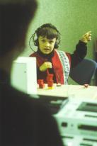 Foto: Kind mit Kopfhörer